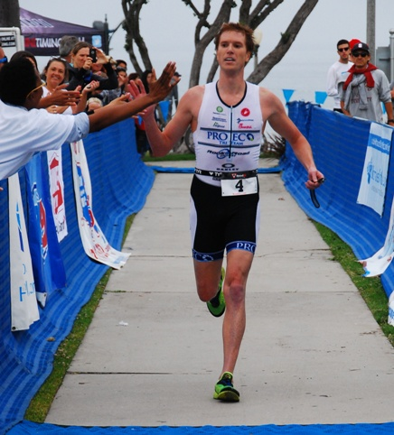 Evan Kraus receives congratulations while winning the 10th Redondo Beach Triathlon. Photo by Randy Angel