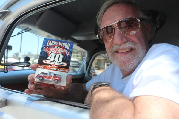 Redondo Beach resident Larry Wood with his 1938 Ford C.O E and the Hot Wheels model of the truck that he designed for Mattel. Photos by Kevin Cody