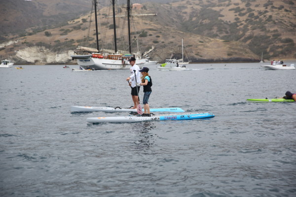 Belah Ellis, 11, accompnied by dad Rodney is belived to have been the youngest person to have paddled solo across the Catalina Channel. Photo by Joel Gitelson
