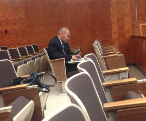 Andrew Yamamoto sat alone in the courtroom gallery on May 20 listening to his lawyers argue against aspects of his arbitration agreement. Photo by Alyssa Morin.
