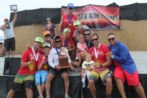 Al Ching and fellow members of the Lanakila Outrigger Canoe club with the Outrigger Iron Perpetual Trophy, presented to the club with the most points at the end of the season.