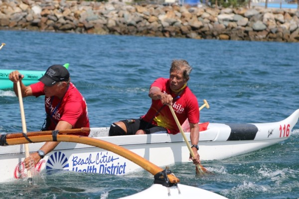 """Ching """"pokes"""" the water to turn his boat in the direction of the finish line at the Iron Championships in San Diego."""