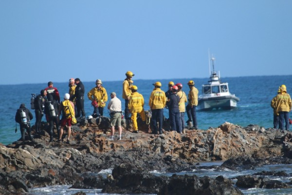 Rescuers wait on a rock reef outside at Inspiration Point.