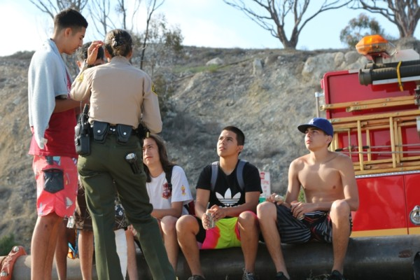 A Los Angeles County Sheriff questions friends of the missing youth.