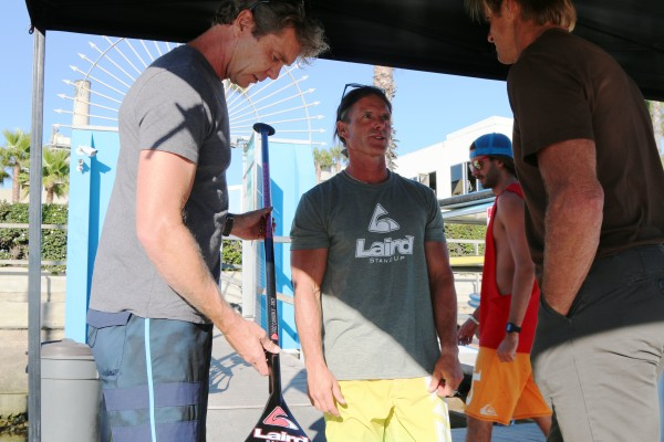 Rupert Nottall-Smith, Gene Smith and Laird Hamilton discuss Hamilton's new paddle.