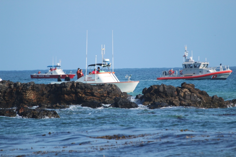 Rescue boats from the Long Beach Fire Department, Los Angeles County Lifeguards Department and  the U.S. Coast Coast guard participated in the search for the missing swimmer. Photo by Kevin Cody