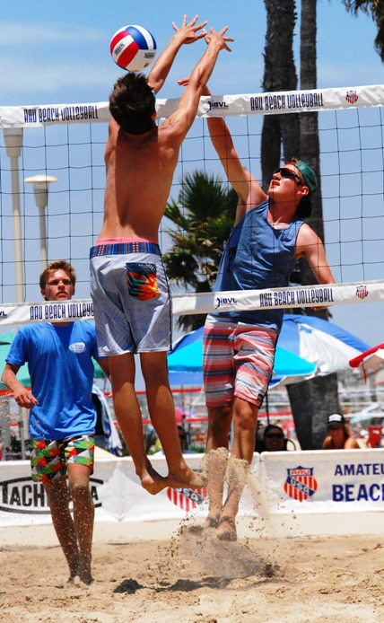 Dane Johnson spikes the ball through a block attempt during the Boys 14U championship game. Photo by Randy Angel