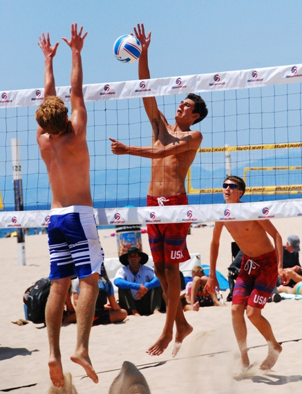 Redondo Beach's Devon Burki takes a hard swing during the Boys U19 championship match. Burki and partner Kyle Skinner will represent the United States at the  FIVB U19 World Championships in Portugal. Photo by Randy Angel