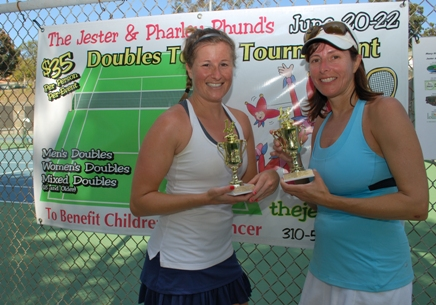 Jenni Hibbard and Vicki Thorrens display their trophies after winning the Women's Doubles A Division competition.