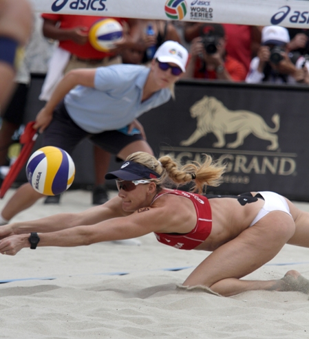 Manhattan Beach's Kerri Walsh goes low to make a pass for partner April Ross. The duo won its sixth FIVB gold medal on Sunday. Photo by Ray Vidal