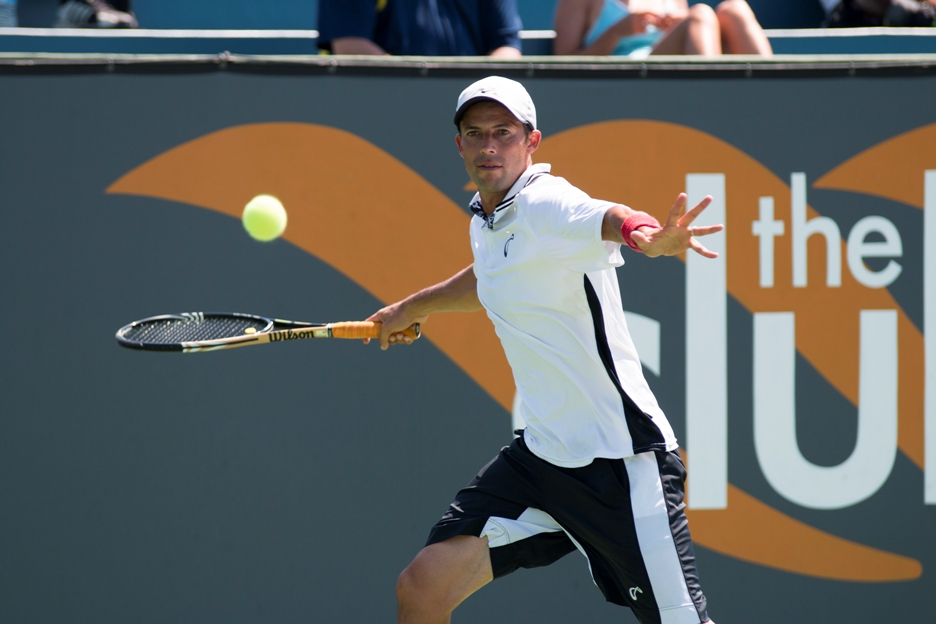 Lester Cook makes a return en route to winning the Manhattan Beach Open tennis championship. Photo by Brad Jacobson