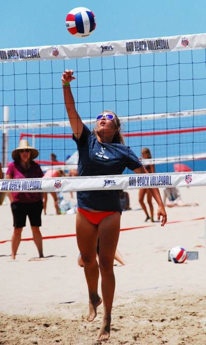 Manhattan Beach's Presley Forbes knuckles the ball for a point to help win the Girls 15U gold medal. Photo by Randy Angel