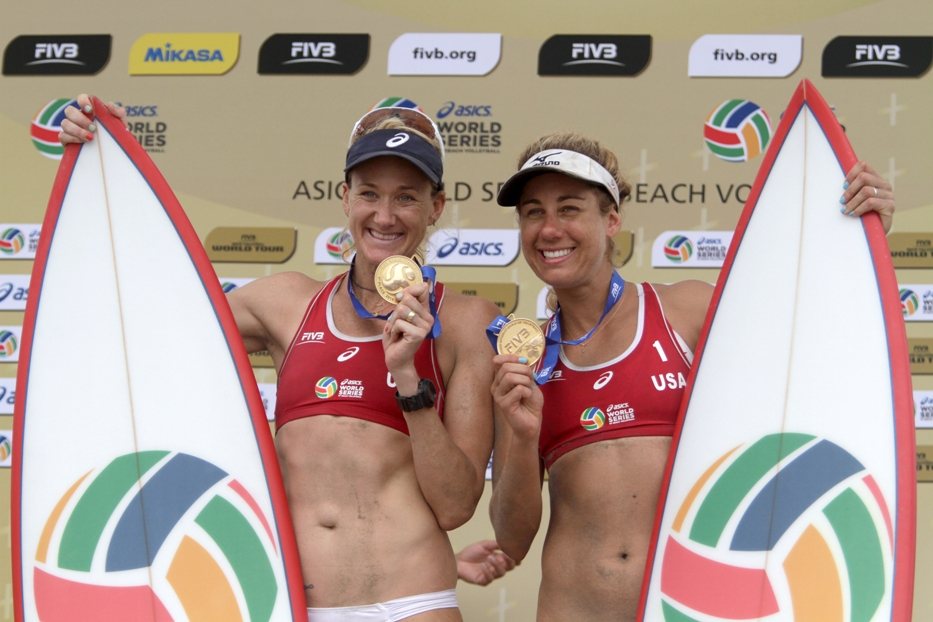 Kerri Walsh and April Ross celebrate their gold-medal winning performance at the ASICS World Series of Beach Volleyball. Photo by Ray Vidal