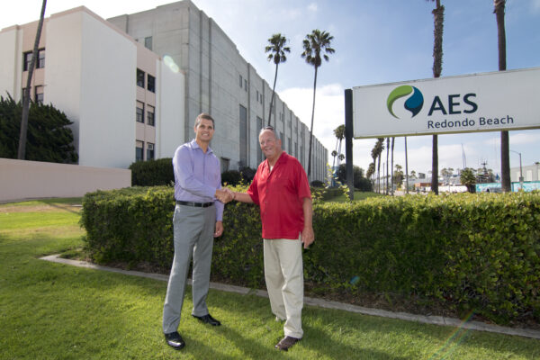 AES vice president Eric Pendergraft and Redondo Beach Mayor Steve Aspel bury the hatchet after decades of conflict, including litigation, between their respective parties. Photo by Brad Jacobson
