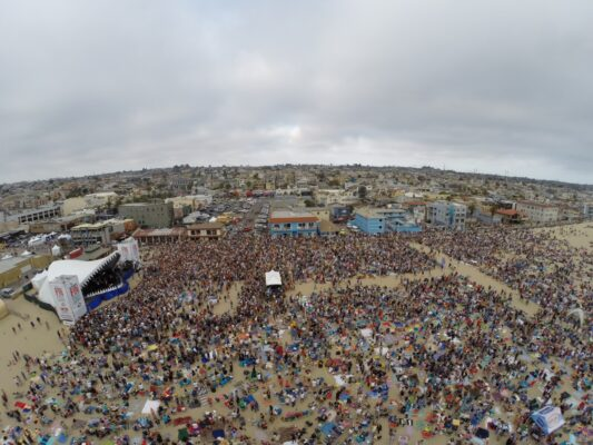 Crowds up people watch Jimmy Buffet and his band perform at FinFest in Hermosa Beach.