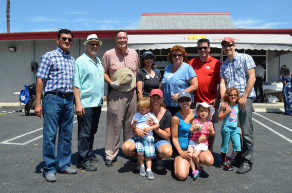 Clark Adams, third from left holding hat, and North Redondo Beach Business Association board members at WalkAbout Redondo on May 18, 2014. Photo Courtesy of NRBBA.