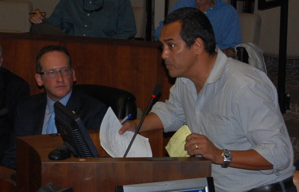 Shark attack victim Steve Robles urges the Council to prohibit fishing from the pier.