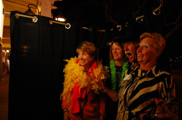Claire Dawson, Sandy Smith Beck, George Hayes and Geri Derby pose for the photobooth
