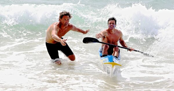 3rd Place Photography. Lifeguards Mel Solberg and Tyler Morgan competing in the South Bay Dozen. By Joel Gitelson