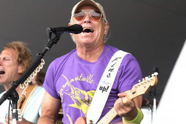 Jimmy Buffett performs, barefoot, on the beach in Hermosa Beach. Photo by Brad Jacobson