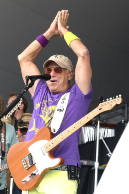 Jimmy Buffett gives his signature greeting to fans at the opening of his Hermosa Beach concert. Photo