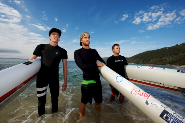 Jack Bark of Palos Verdes, and  Zeb Walsh and Brad Gaul of Australia Waterloo Bay on the east coast of Wilsons Prom, prior to setting out for Tasmania. Photo by Cormac Hanrahan
