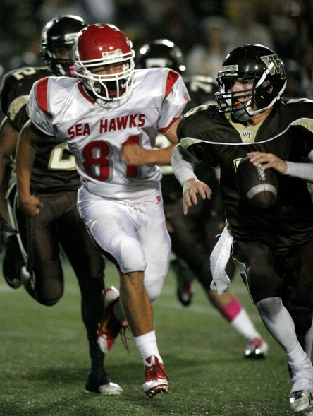 Junior Cedric Muzik leads a physical Redondo defense. Photo by Ray Vidal
