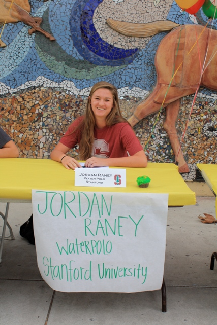 Jordan Raney is all smiles during the National Letter of Intent signing assembly held at Mira Costa in November, 2013. Photo by Tina Raney