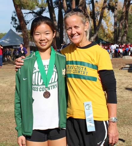 Mira Costa girls cross country and track coach Renee Williams-Smith, right, with University of Pennsylvania-bound Abby Hong at the 2013 State Cross Country Championship. Photo by Jada Hong