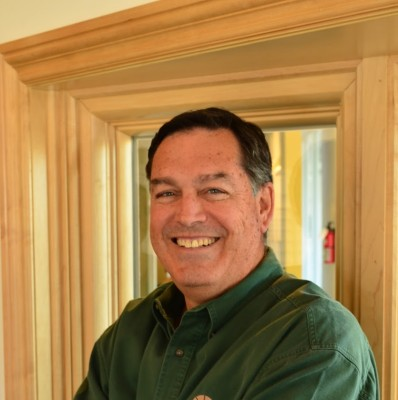 """Six-foot-three Clark Adams always wore a smile and """"was dedicated to making life better for everybody,"""" as Councilman Pat Aust remembered. Photo Courtesy of Clark Adams Windows and Doors"""