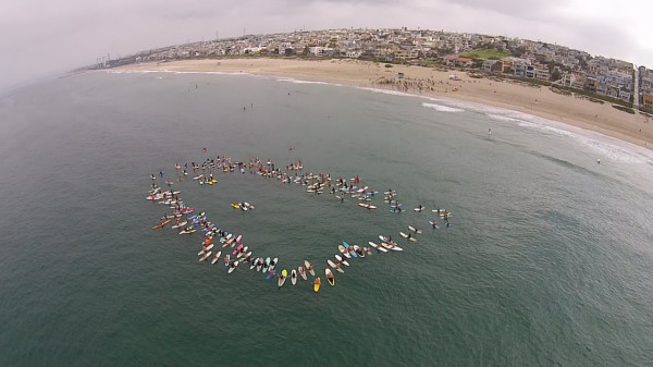 Paddle out in memory of Clint Clausen Friday morning in Manhattan Beach. By Michael Buresh