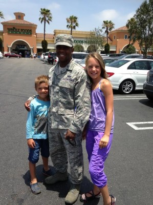 Cameron and Emma Cobb meet a soldier during their day out.
