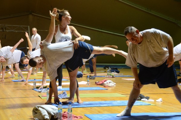 Suzy Nece teaching yoga to American soldiers in Afghanistan in a tour that featured both standup comedy and yoga for the troops. Courtesy Suzy Nece
