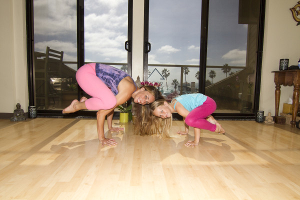 Suzy and Izzy at play at the Yoga Loft. Photo by Brad Jacobson