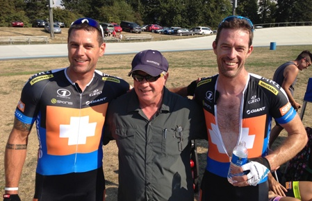 Coach and former two-time Olympian Roger Young stand with Jon Davy, left, and Kevin Phillips.