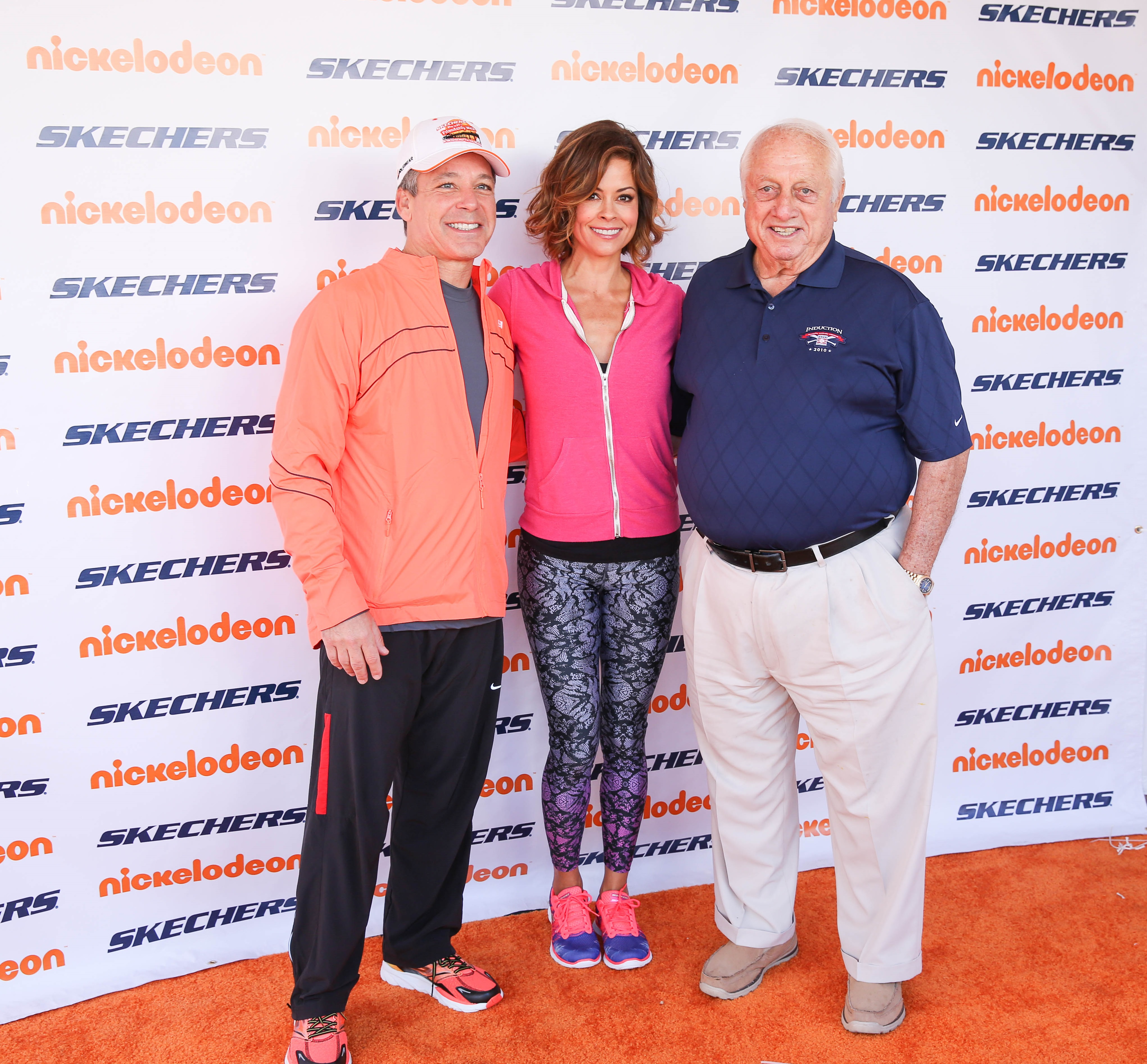 Skechers President Michael Greenberg, television personality Brooke Burke-Charvet and former Dodgers Manager Tommy Lasorda at the 2014 Skechers Pier to Pier Friendship Walk. Photo courtesy of Skechers Foundation