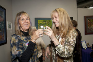 Artists Susan Lilly and Tasha Garfield toast the grand opening of Destination: Art last Saturday in Torrance GLORIA PLASCENCIA, CONTRIBUTING PHOTOGRAPHER