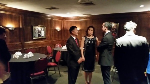 State Senator and Congressman-elect Ted Lieu celebrates with his wife, Betty Chin, and Los Angeles Mayor Eric Garcetti. Photo