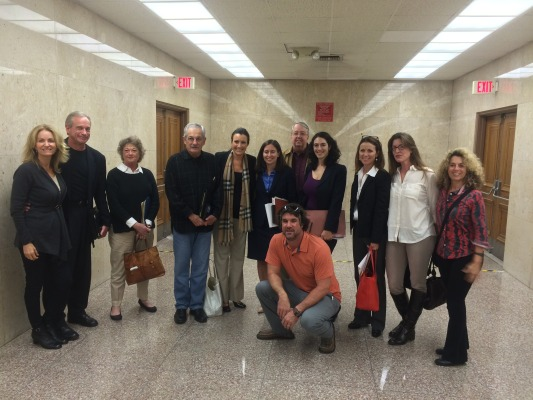 The anti-oil group outside the courtroom after their legal victory. Photo by Alyssa Morin