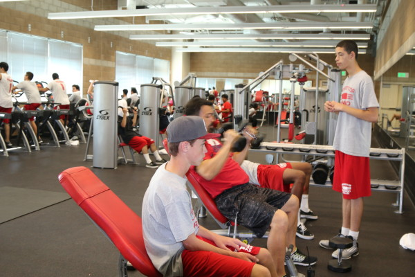 The new weight training room is equipped with free weights and Cybex workout stations. Photo by Kelley Kim
