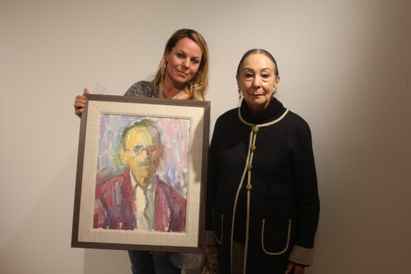 Maclovia and Carmen Martel, with Paul Jean Martel's last self-portrait. Photo by Bondo Wyszpolski