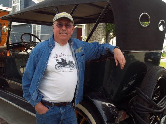 Torrance resident Ron Schroeder stands by his 1922 Stanley Steamer. Photo .