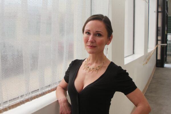 Laura Orr, modeling Krisjan Klenow's jewelry. Photo by Bondo Wyszpolski