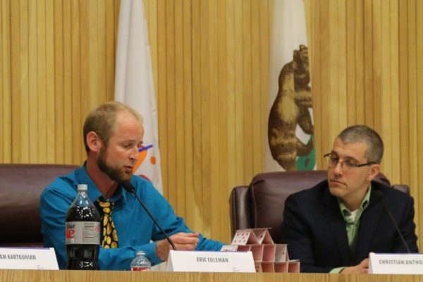 Redondo Beach District 3 City Council Candidate Eric Coleman handles his house of cards as fellow candidate Christian Anthony Horvath looks on. Photo by David Mendez