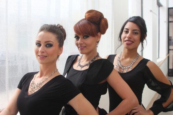 Silke Kindle, Ingrid Gethsybe Dietrich, and Barbara Sandifor (l-r) model Krisjan Klenow's original jewelry. Photo by Bondo Wyszpolski