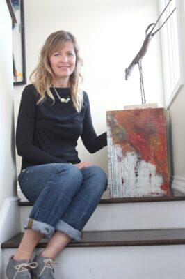 Artist Sabrina Armitage shows one of her paintings in her Manhattan Beach home. Photo