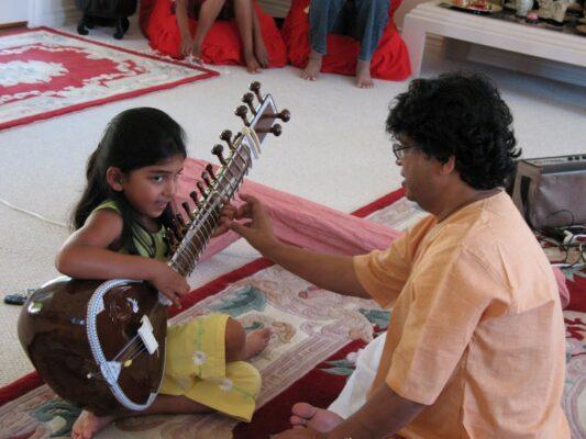 "Aloke Dasgupta teaching at his music school, Raja Ranjani, which means ""music that makes you happy."" Photo courtesy Aloke Dasgupta"