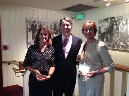 Guthrie 1.jpg Redondo Beach Round Table president Chris Cagle presents the 2015 Business in Excellence Award to King Harbor Marina lessees Tara Guthrie and Maryann Guthrie during the organization recent luncheon at the Blue Water Grill in King Harbor.