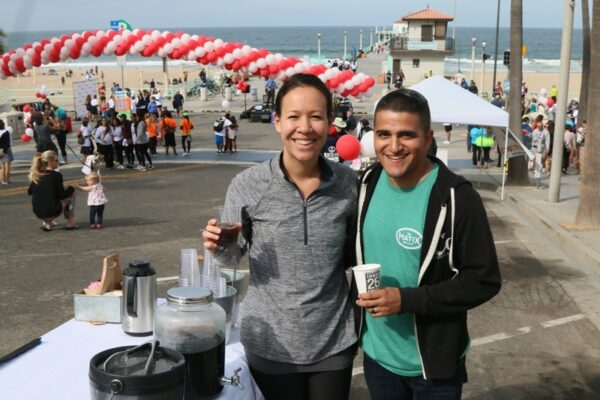 Ali and Joe Pimental hand out cups of their Three 25 fresh roast coffee to walkers at the Richstone Pier to Pier Walkathon.