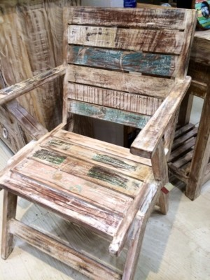 An Adirondack style chair from reclaimed wood evokes Yorktown owner Karen McBride's  East Coast roots.